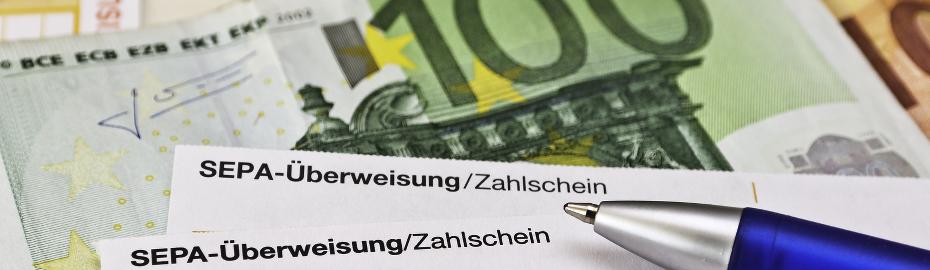 100 € Schein und SEPA-Überweisungsschein